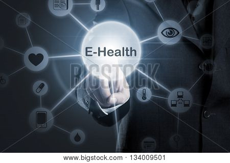 Hand touching E-Health symbol connected to health medical and technology symbols