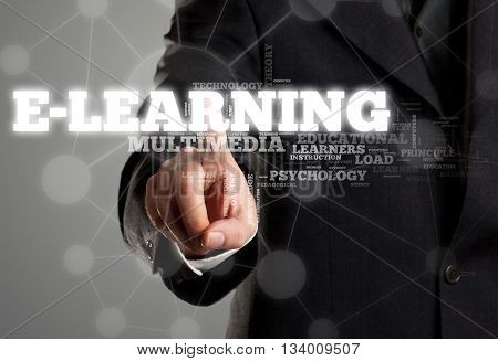 Businessman touching e-learning in wordcloud on transparent surface display