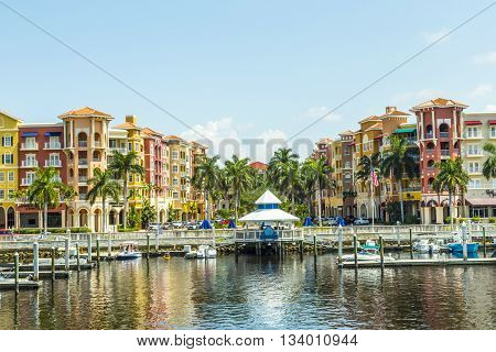 NAPELS, USA - AUG 3, 2013:Colorful Spanish influenced buildings overlooking the water in tropical Naples Florida .