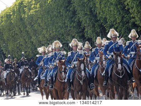 STOCKHOLM - JUN 06 2016: The Royal guards on the horse back protecting the swedish royal family on their way to celebrate the swedish national day