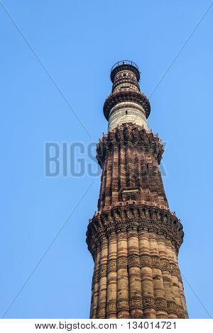 Qutub Minar Tower or Qutb Minar the tallest brick minaret in the world Delhi India. poster