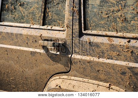 close up on dirty vehicle full of dirt