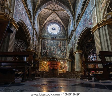 CREMONA ITALY - APRIL 26 2016: View of the nave and the inner facade of the Cremona's Cathedral. The Golgotha frescoed by Pordenone in 1521 dominates the nave.