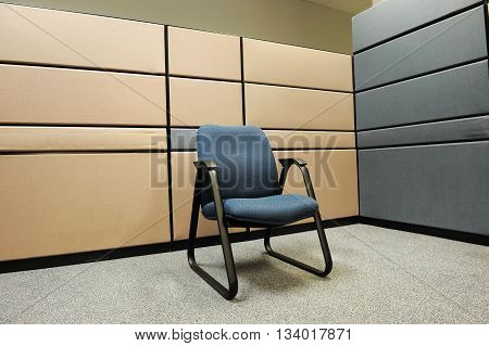 close up on single chair in empty cubicle