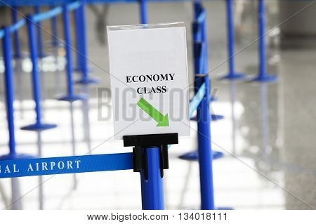 economy waiting line with nobody in airport