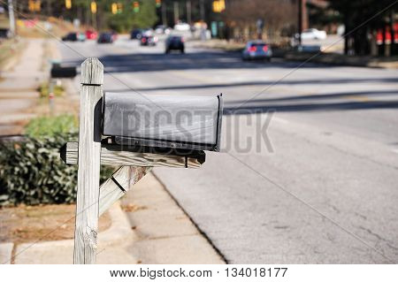 close up on old mail box near the street