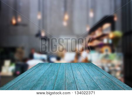 Perspective blue wooden with blurred background in coffee shop, stock photo