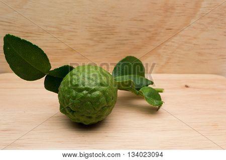 Kaffir lime Thai herbs on a wooden background.
