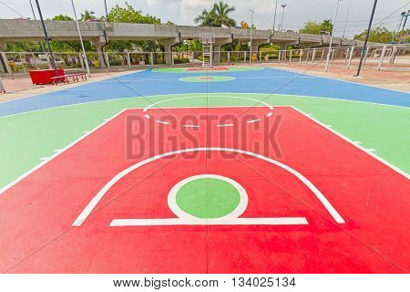 Colorful outdoor basketball court in local school