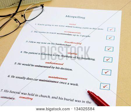 blue check mark box next to english sentence on white exercise sheet