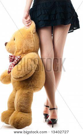 Chica sexy con oso de juguete