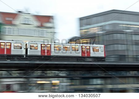 train with speed in motion in the evening