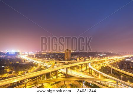 busy traffic on road junction in nanjing at night