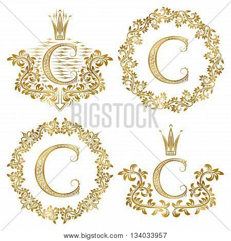 Golden letter C vintage monograms set. Heraldic monogram in coats of arms form letter C in floral round frame letter C in wreath heraldic monogram in floral decoration with crown.