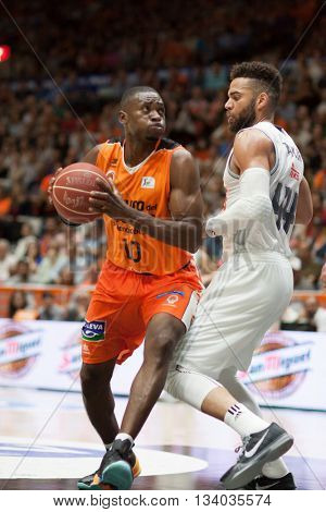 VALENCIA, SPAIN - JUNE 9th: Sato with ball and Taylor during 4th playoff match between Valencia Basket and Real Madrid at Fonteta Stadium on June 9, 2016 in Valencia, Spain