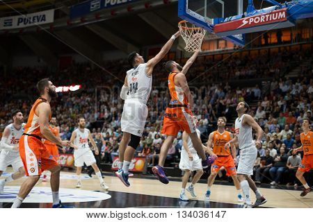 VALENCIA, SPAIN - JUNE 9th: Diot with ball and Ayon (14) during 4th playoff match between Valencia Basket and Real Madrid at Fonteta Stadium on June 9, 2016 in Valencia, Spain