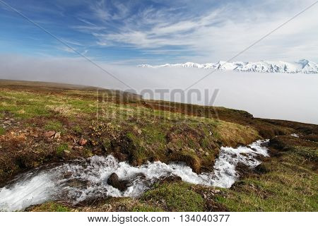 Iceland with river and mountin at day.