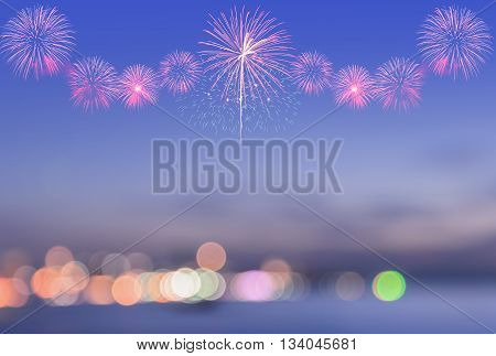 Firework on blurred twilight sky background with colorful city lights bokeh on a shore