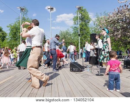 Moscow - May 9 2016: Dance workshops Soviet retro school Jiving Rockets music group Rock'n'Lora on the dance floor and people dancing Gorky Park May 9 2016 Moscow Russia