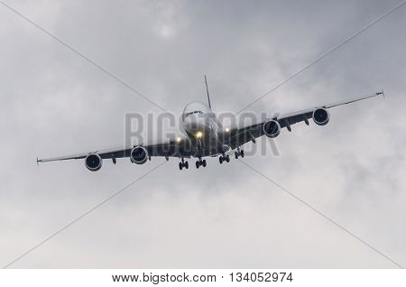 Passenger airliner approaching for landing in bad weather