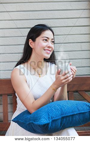 Beautiful Asian Woman Enjoys Fresh Coffee In The Morning. Happy Time Of City life.
