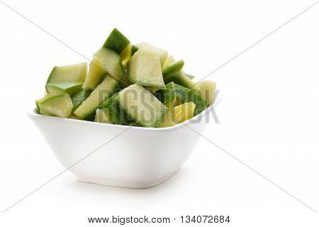 Organic sliced Indian Mango (Mangifera indica), in white bowl. Isolated on white background. Front view.