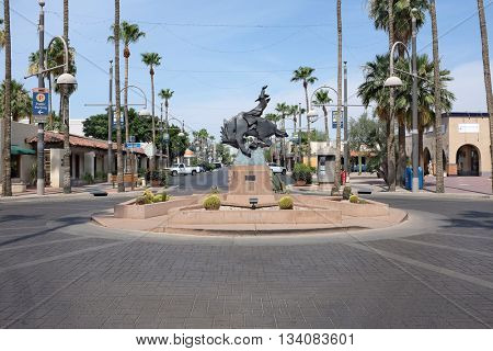 SCOTTSDALE, ARIZONA - JUNE 10, 2016: Jack Knife sculpture on Main Street. The bronze statue, by Ed Mell, of a rider on a bucking horse was inspired by the city's official seal.