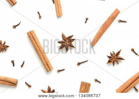 Set of cinnamon, clove and star anise, scattered in a chaotic manner, isolated on white background