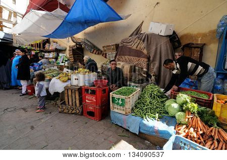 FES - MARCH 10: Unknown man trades a vegetables in a Market (souk) in a city Fes in Morocco. The market is one of the most important attractions of the city. March 10, 2012 Fes, Morocco.