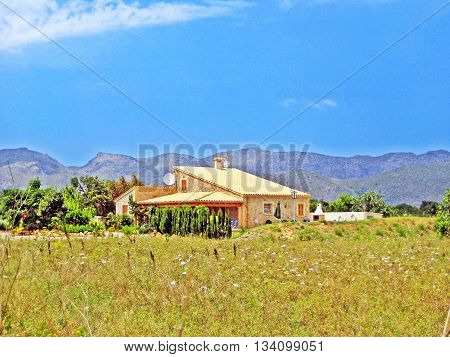 Majorca Spain - June 28 2008: Finca / rural country home - tramuntana mountains in the background meadow in front