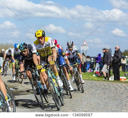 Hornaing France - April 10,2016: The Belgian cyclist Sep Vanmarcke of Lotto NL-Jumbo Team riding in the peloton on a paved road in Hornaing France during Paris Roubaix on 10 April 2016.
