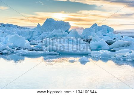 Beautiful view of icebergs in Jokulsarlon glacier lagoon at sunset Iceland selective focus global warming and climate change concept