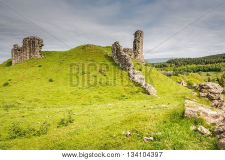 Harbottle Castle in ruins, a medieval site situated on a mound in the Coquetdale Valley Northumberland