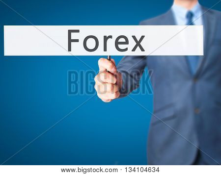 Forex - Businessman Hand Holding Sign