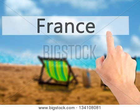 France - Hand Pressing A Button On Blurred Background Concept On Visual Screen.