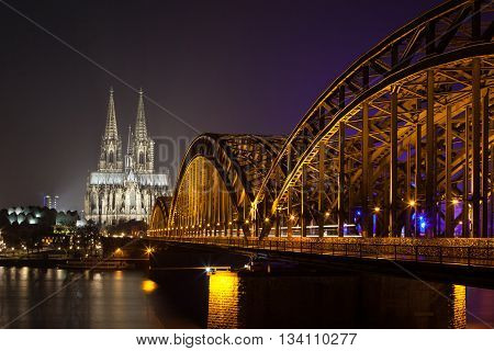 Cologne Cathedral with the Hohenzollern bridge at night