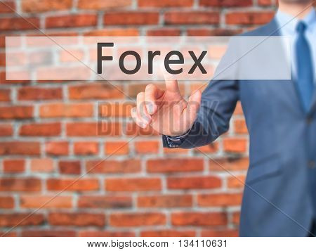 Forex - Businessman Hand Pressing Button On Touch Screen Interface.