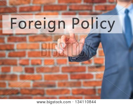 Foreign Policy - Businessman Hand Pressing Button On Touch Screen Interface.