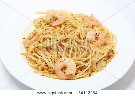 Seafood Spaghetti with prawn and herbs on plate shite background