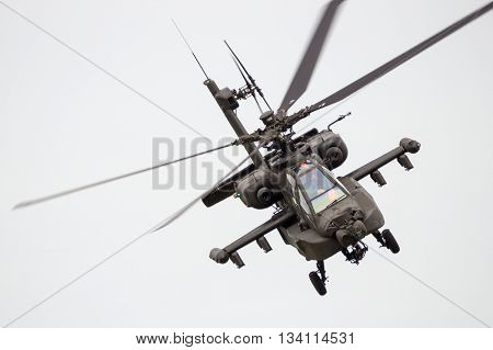 LEEUWARDEN THE NETHERLANDS - JUN 10 2016: front view of a Boeing AH-64 Apache attack helicopter flying