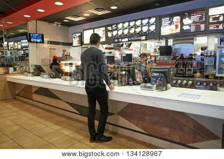 NEW YORK - CIRCA MARCH, 2016: inside of McDonald's restaurant. McDonald's is the world's largest chain of hamburger fast food restaurants, founded in the United States.