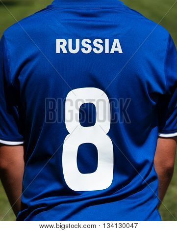 Soccer player wearing the jersey on the country Russia