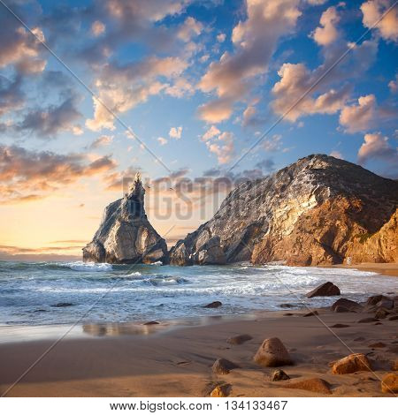 Fantastic big rocks and stones on the ocean beach at sundown. Beauty world landscape. Portugal, Europe