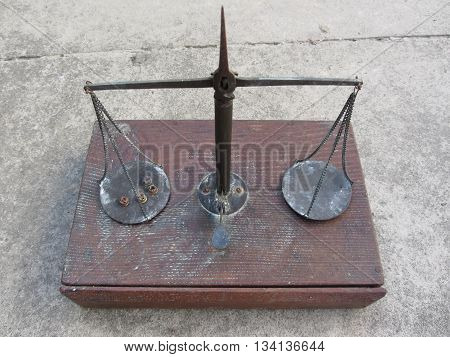 Vintage handmade balance scale with hunting cartridge primers on the left plate