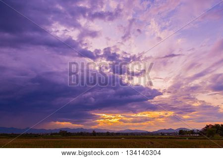 View Farm Field Meadow And Dramatic Clouds Sunset In Thailand.