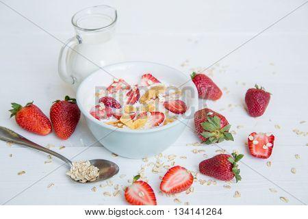 Breakfast porridge with fresh strawberry and milk