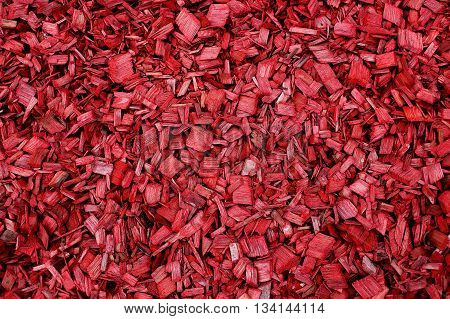 red wood chips. red garden mulch background. Texture