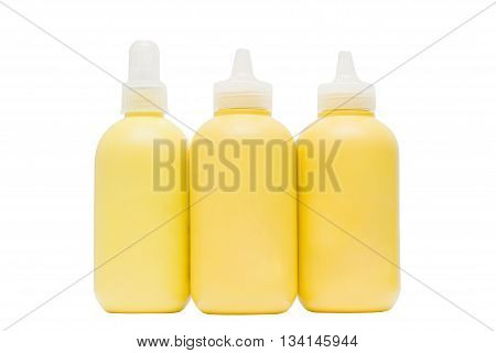 Yellow cosmetic bottle isolated on white table