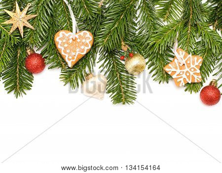 Christmas green fir tree with star cookies and red ball isolated on white