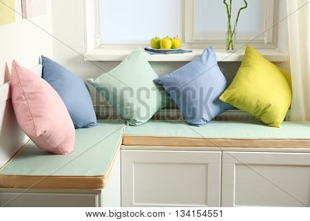 Colorful pillows on nook furniture